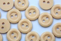 Κουμπί στρογγυλό με δύο τρύπες